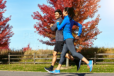 Buy stock photo Shot of people running outdoors