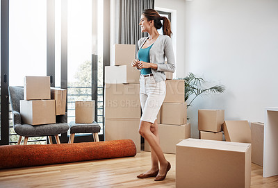 Buy stock photo Full length shot of an attractive young woman looking thoughtful while moving into a new house