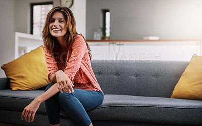 Buy stock photo Shot of a beautiful young woman spending the day at home