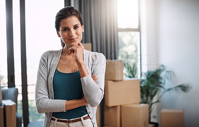 Buy stock photo Cropped portrait of an attractive young woman standing in her new home while moving in
