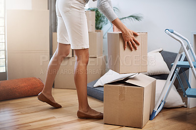 Buy stock photo Cropped shot of an unrecognizable young woman moving into her new house