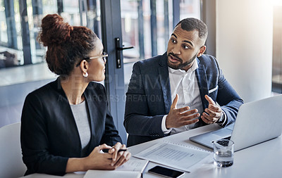 Buy stock photo Shot of two businesspeople having a discussion in an office