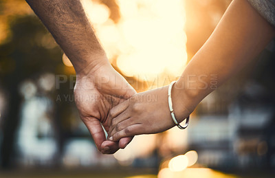 Buy stock photo Closeup shot of an unrecognizable couple holding hands outdoors