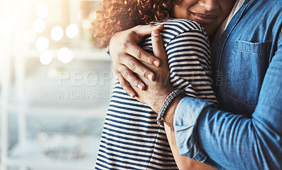 Buy stock photo Cropped shot of an unrecognizable couple embracing