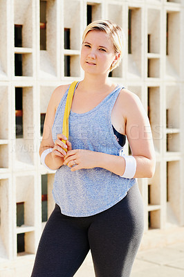 Buy stock photo Portrait of an attractive young woman working out in the city