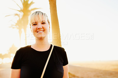 Buy stock photo Portrait of an attractive young woman spending the day on the promenade