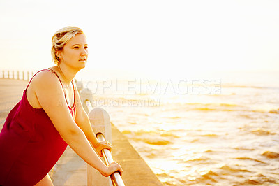 Buy stock photo Cropped shot of an attractive young woman working out on the promenade