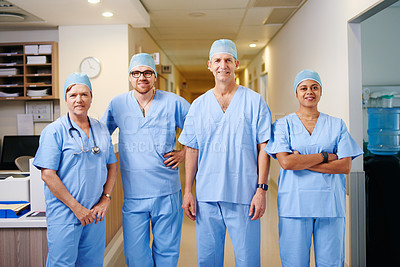 Buy stock photo Cropped portrait of a team of doctors standing in their hospital