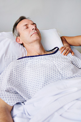 Buy stock photo Cropped shot of an unrecognizable woman and her husband visiting her father in the hospital