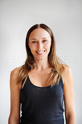 Buy stock photo Portrait of a cheerful young aged woman wearing yoga clothes before a session inside of a studio
