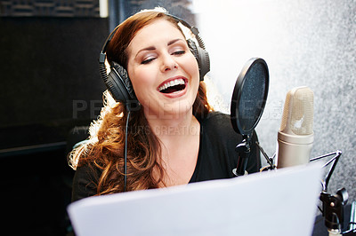 Buy stock photo Shot of a woman speaking into a microphone