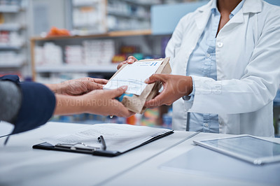 Buy stock photo Closeup shot of an unrecognizable pharmacist assisting a customer in a chemist