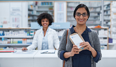 Buy stock photo Portrait of a mature woman standing in a chemist with a pharmacist in the background
