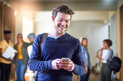 Buy stock photo Shot of a university student using a cellphone at campus
