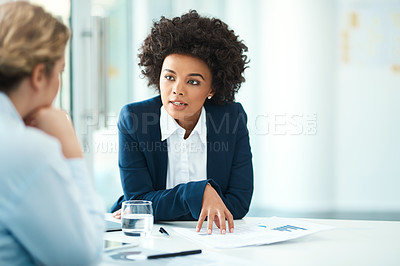 Buy stock photo Shot of two businesspeople having a discussion in a modern office