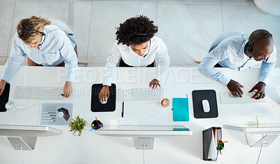 Buy stock photo High angle shot of a team of call centre agents working in an office