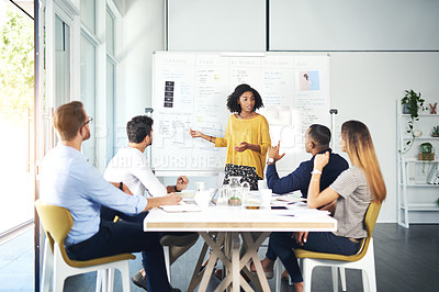 Buy stock photo Cropped shot of an attractive young businesswoman giving a presentation during a meeting in the boardroom