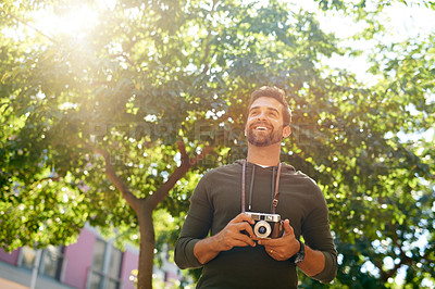 Buy stock photo Cropped shot of a handsome young man taking photographs during his morning commute