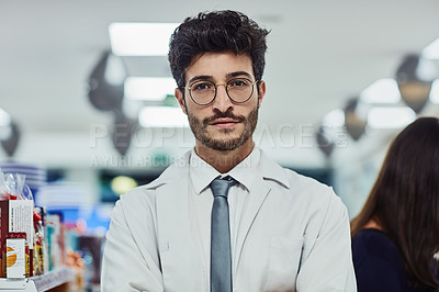 Buy stock photo Cropped portrait of a handsome young male pharmacist working in a pharmacy