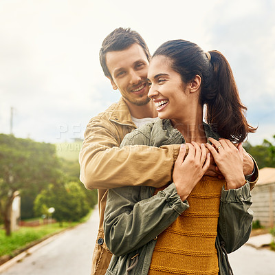 Buy stock photo Cropped shot of an affectionate young couple standing outdoors
