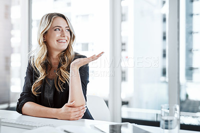 Buy stock photo Shot of a young businesswoman gesturing with her hand at her desk in a modern office