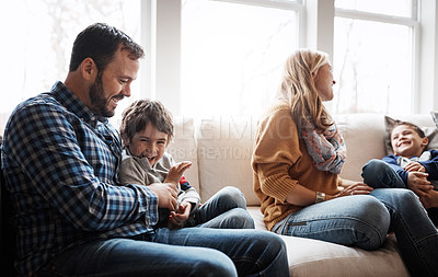 Buy stock photo Portrait of two adorable little boys having fun with their parents at home