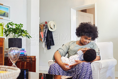 Buy stock photo Cropped shot of a mother breastfeeding her baby girl
