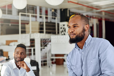 Buy stock photo Shot of two businessmen working in an office