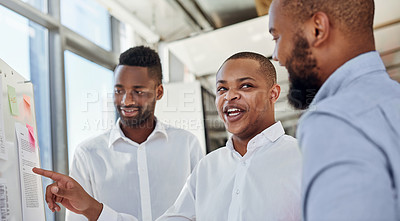 Buy stock photo Shot of a group of businessmen brainstorming with notes on a whiteboard in an office
