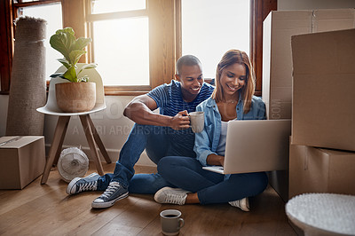 Buy stock photo Shot of a couple using their laptop on moving day