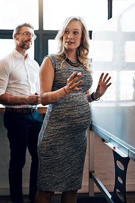 Buy stock photo Shot of a pregnant businesswoman giving a presentation in the boardroom