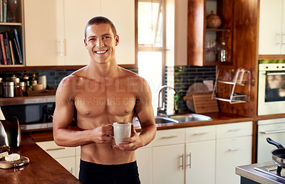 Buy stock photo Cropped shot of handsome young shirtless man drinking a cup of coffee in the kitchen at home