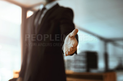 Buy stock photo Closeup shot of an unrecognizable businessman extending a handshake in an office