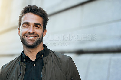 Buy stock photo Cropped portrait of a handsome young man traveling through the city