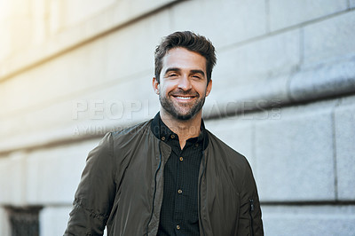 Buy stock photo Cropped portrait of a handsome young man in the city