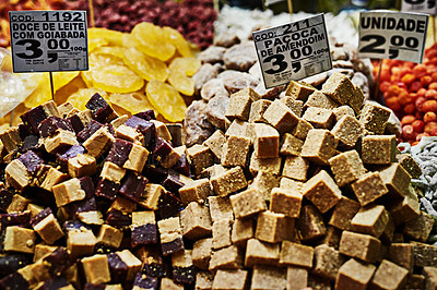 Buy stock photo Shot of a bunch of different delicious treats placed next to each other at a market stall outside during the day