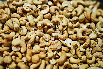 Buy stock photo Shot of numerous amounts of nuts being displayed at a market during the day