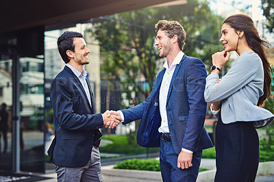 Buy stock photo Shot of businesspeople meeting and greet outside