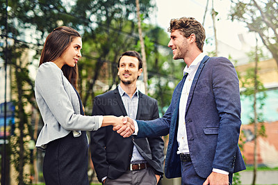 Buy stock photo Cropped shot of businesspeople meeting and greeting outside