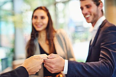 Buy stock photo Cropped shot of a businessman and businesswoman checking into a hotel