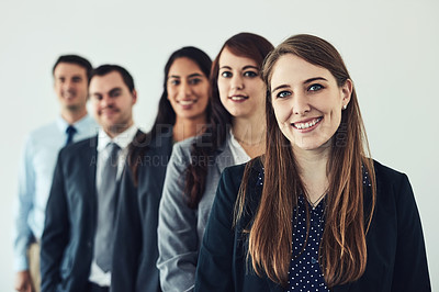 Buy stock photo Studio shot of a group of confident young businesspeople standing together in a row