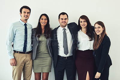 Buy stock photo Studio shot of a group of confident young businesspeople standing together