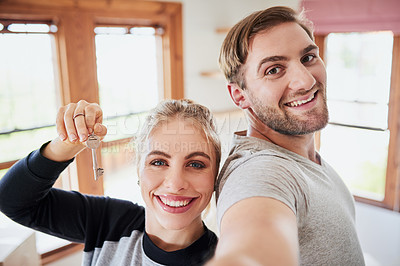 Buy stock photo Shot of a happy young couple on moving day in their new home