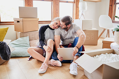 Buy stock photo Shot of happy young couple on moving day in their new home