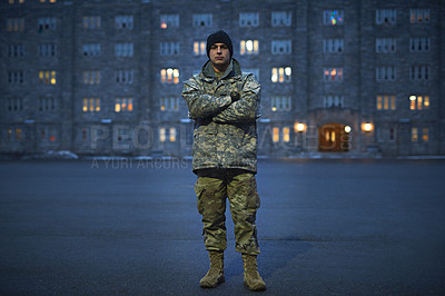 Buy stock photo Shot of a young soldier standing outside on a cold day at military school