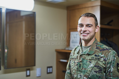 Buy stock photo Shot of a young soldier standing in the dorms of a military academy
