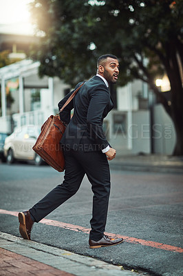 Buy stock photo Shot of a handsome young businessman in the city