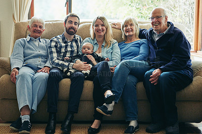 Buy stock photo Portrait of a three-generational family sitting together on a sofa at home