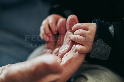 Buy stock photo Closeup shot of a baby holding their grandparent's hand