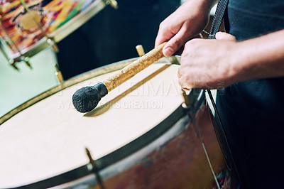 Buy stock photo Cropped shot of a group of unrecognizable male drummers playing at Carnival